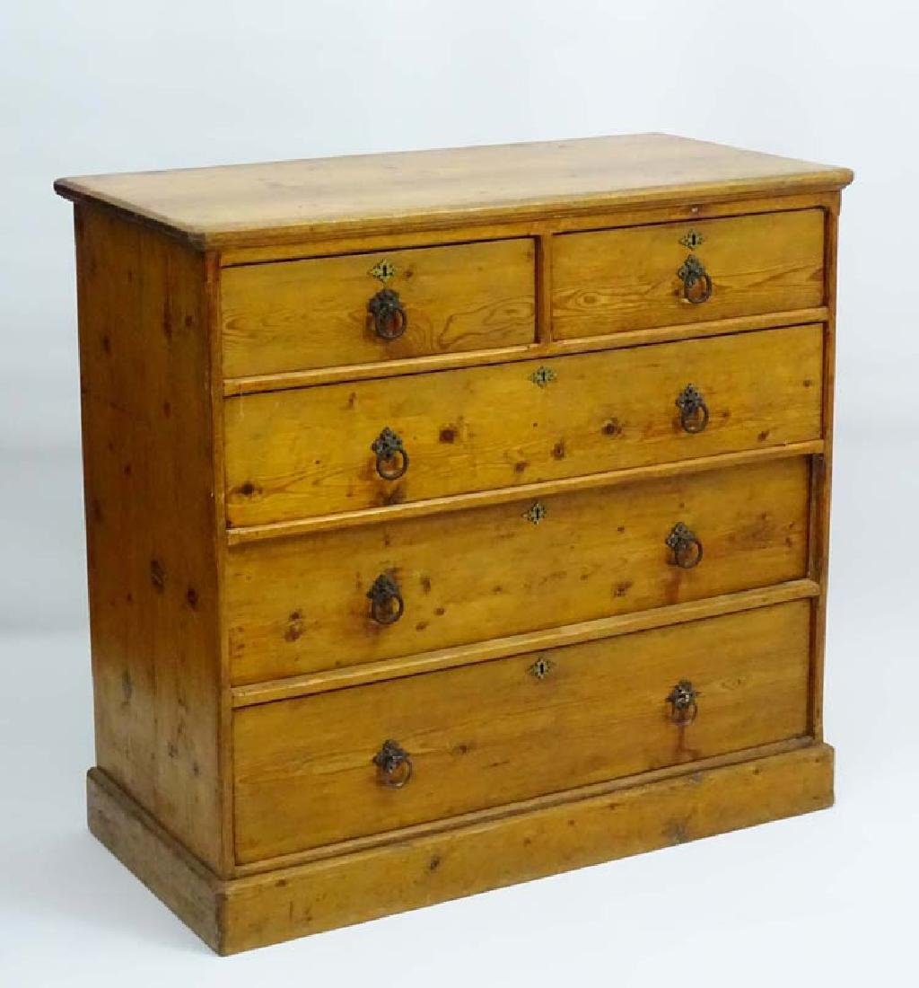 A late 19thC reformed Gothic pine Chest of two short