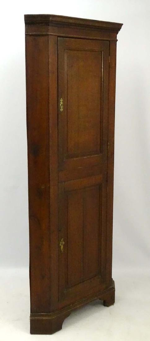 An 18/19thC oak Corner Cupboard with two sectional