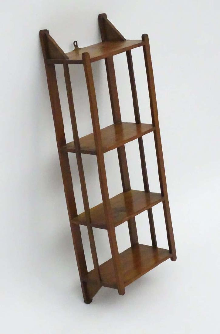 An Edwardian mahogany small set of Shelves inspired by