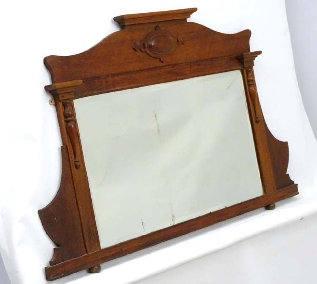 A late 19thC walnut overmantle Mirror with bevelled