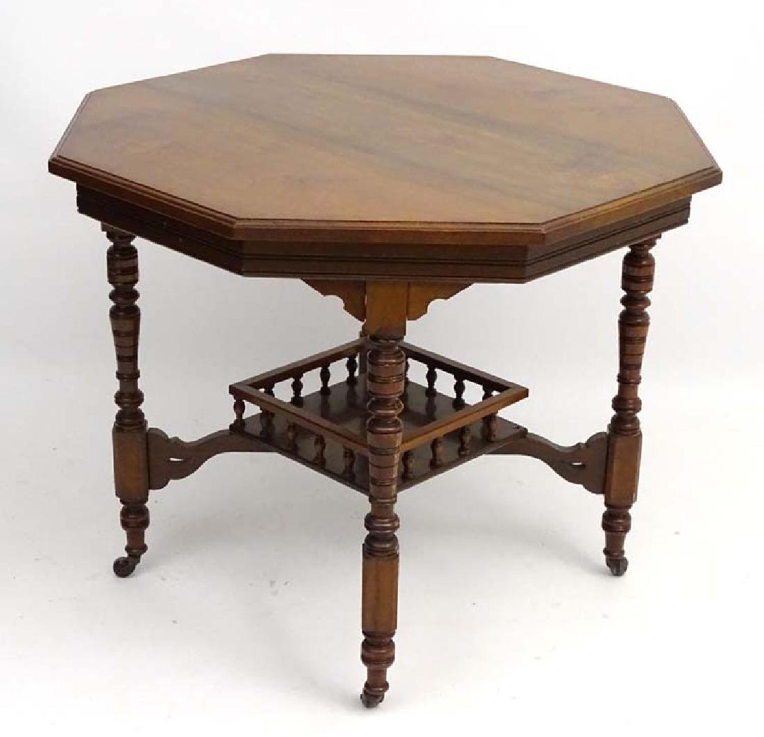 A Victorian walnut octagonal two tier Occasional Table,
