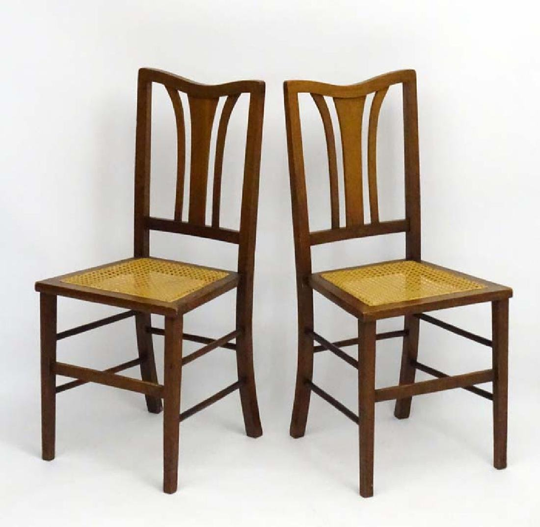 A pair of early 20thC mahogany cane seated bedroom