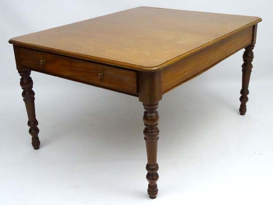 A late 19thC mahogany Library Table with draws at