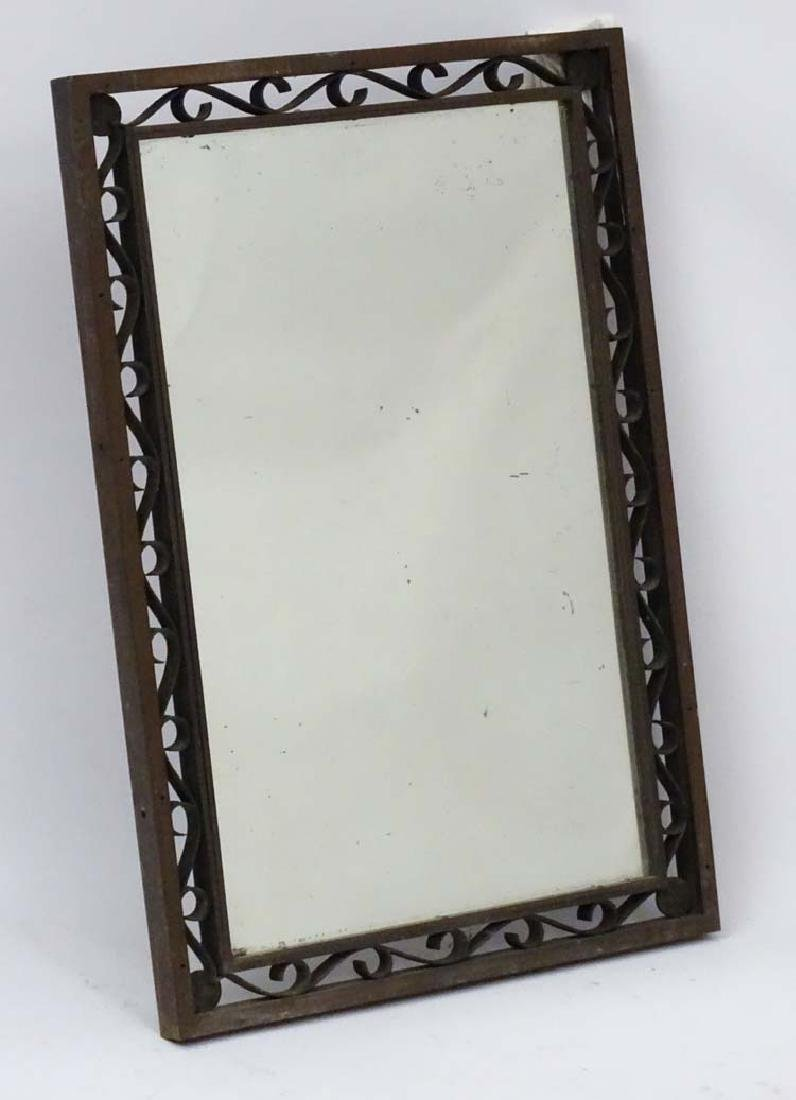 An industrial bronze rectangular mirror with scrolling