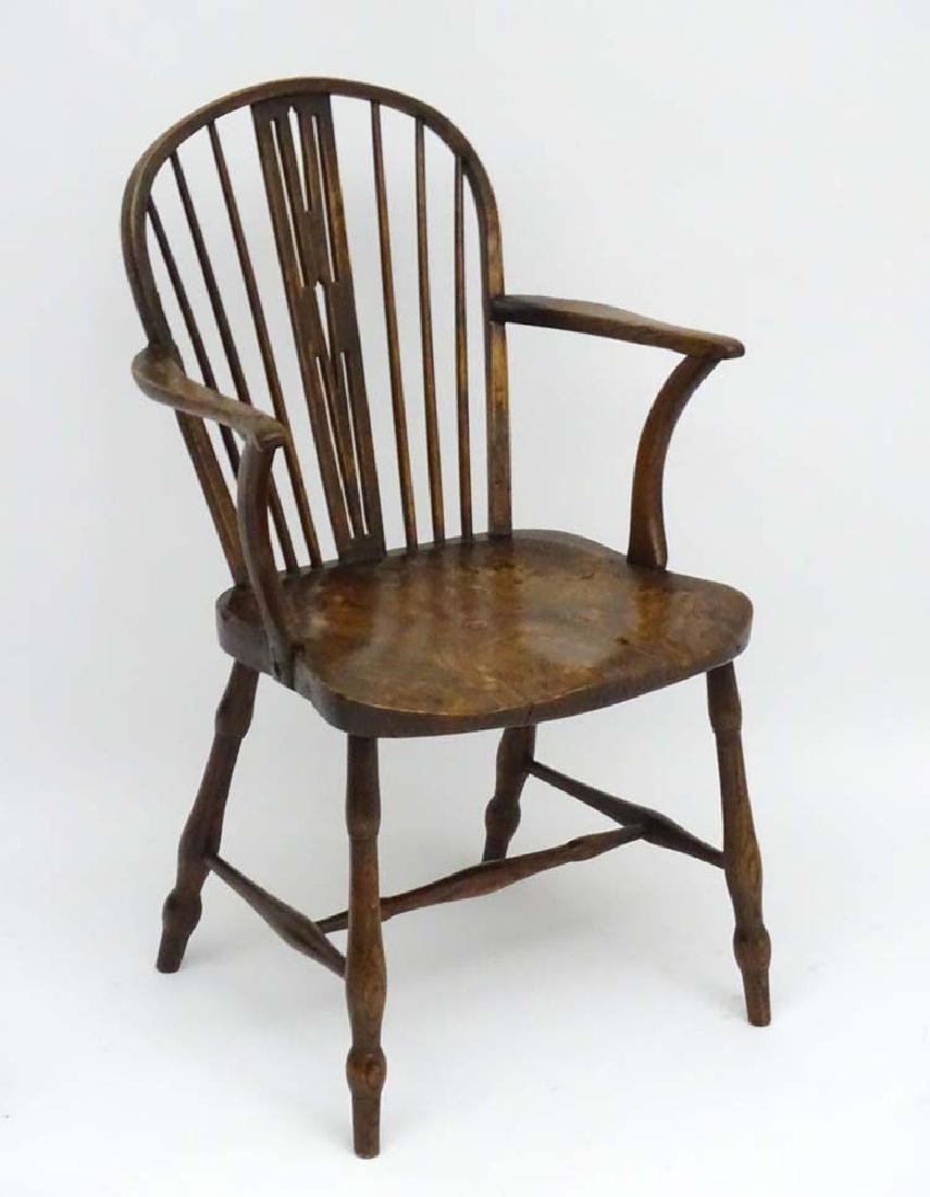 An early 19thC ash and elm Windsor Chair with pierced