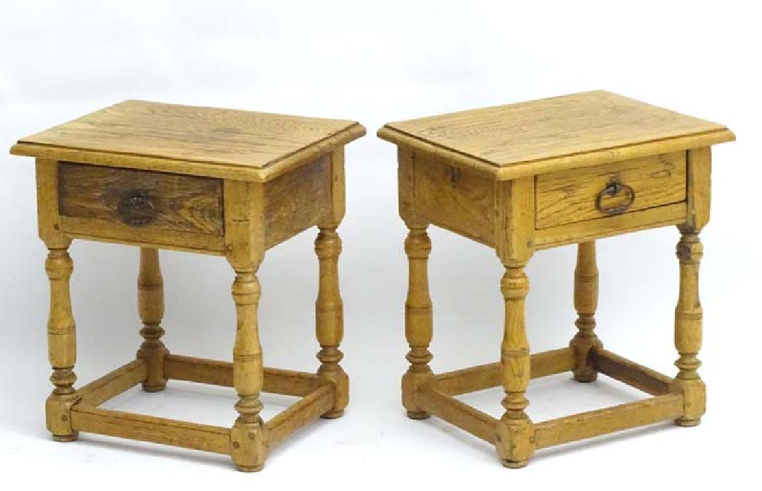 A pair of early 20thC oak bedside cabinets both having