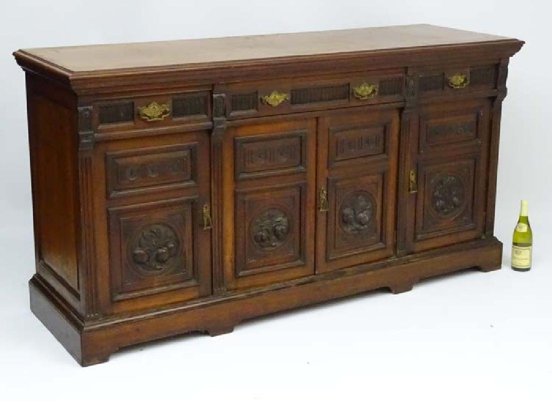 A Victorian walnut three drawer Sideboard with pilaster