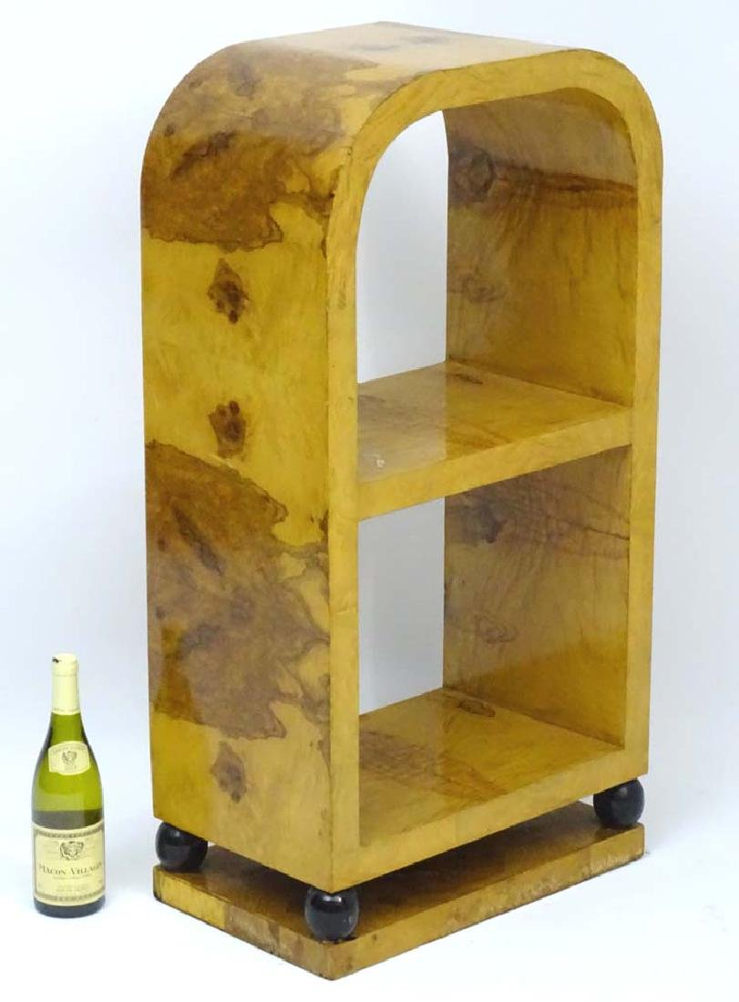 Art Deco: A satinwood Bookcase of curved form standing
