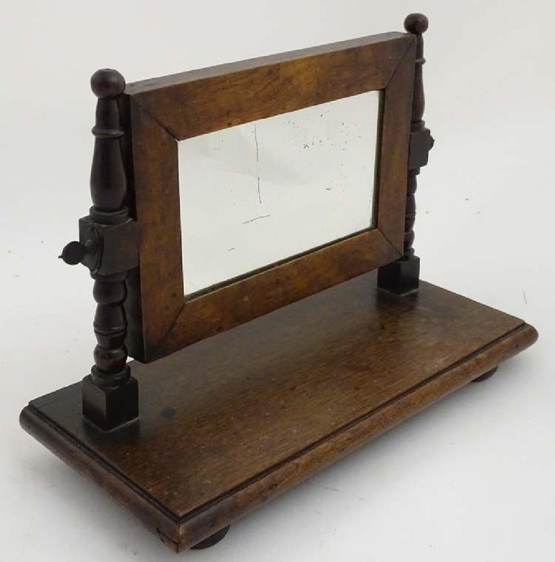 An early 19thC walnut Toilet Mirror having turned