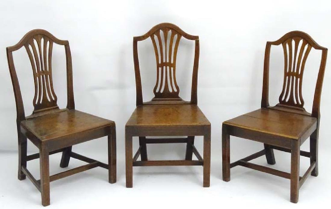 A trio of late 18thC Hepplewhite style dining chairs