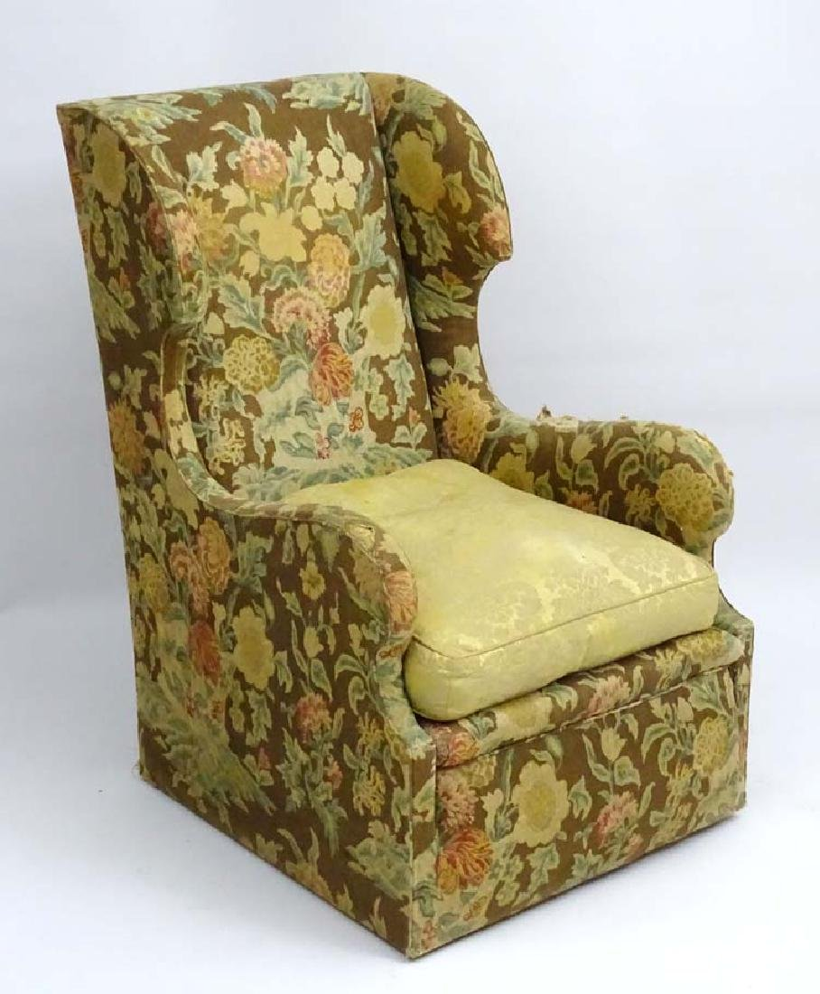 Arts and Crafts: A sleigh style Wingback Armchair with