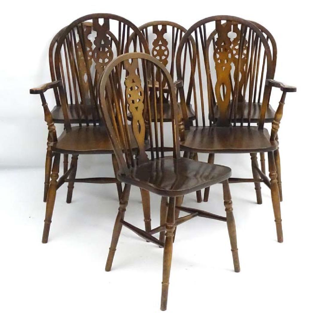 A set of 6 (4+2) mid / late 20thC oak wheelback chairs