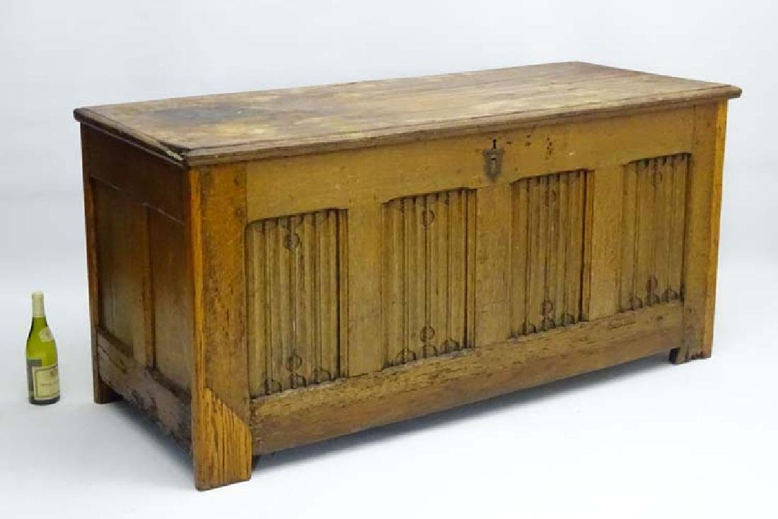 A 17thC oak Coffer of large proportions with a linen