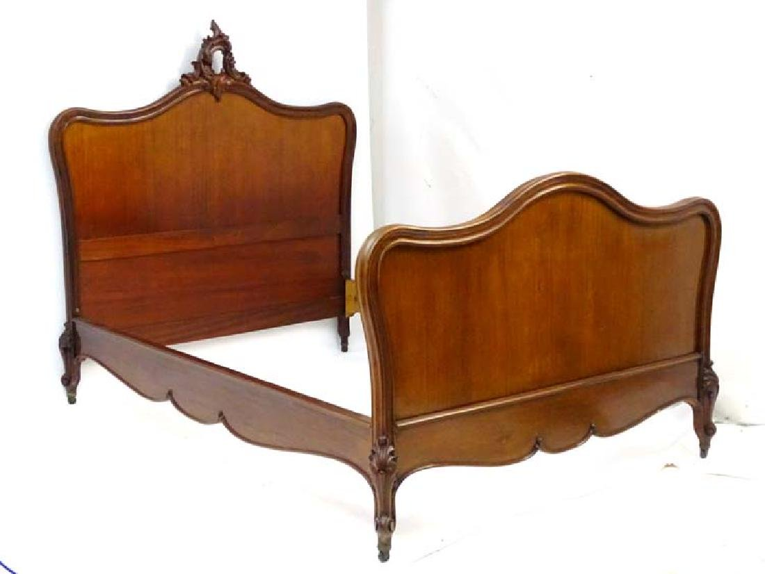 A Louise XV style mahogany Bed with an ornate floral