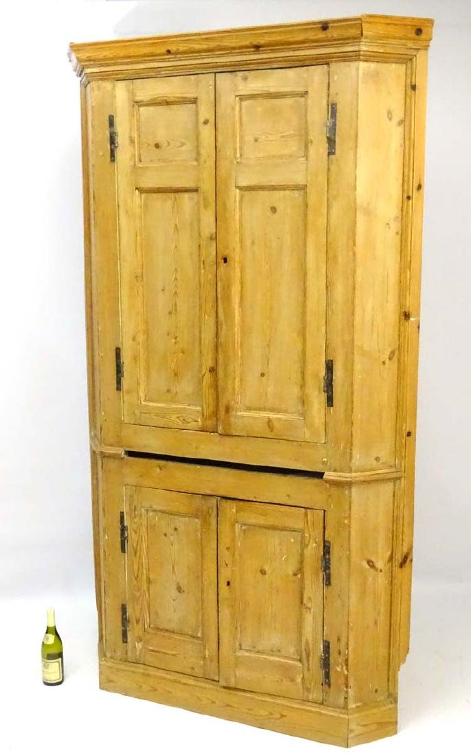 A Victorian pine freestanding four door Corner Cupboard
