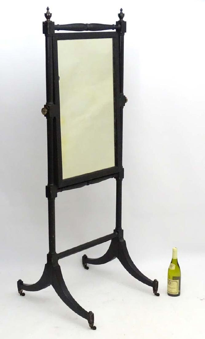 A 19th/20thC ebony Cheval Mirror with turned finials
