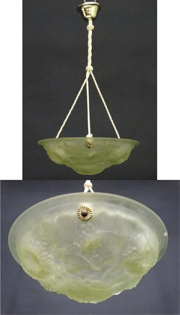 A 1920's Art Deco frosted glass light shade of circular