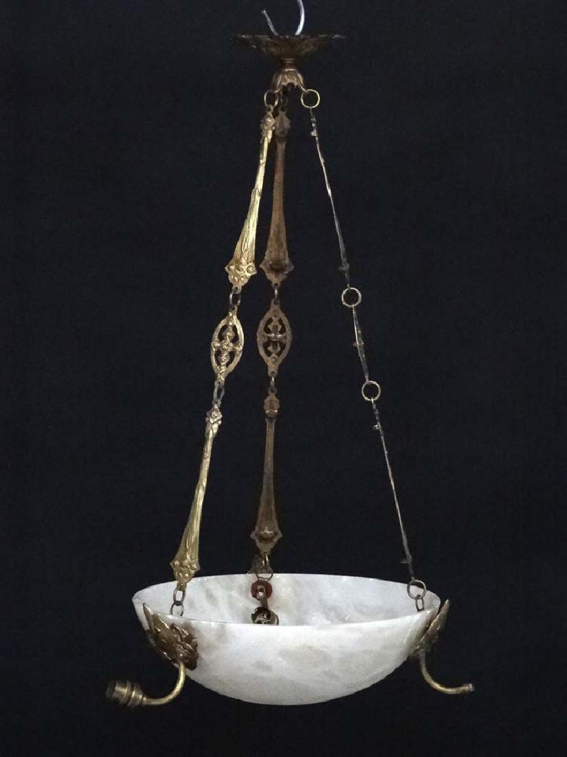 An Art Deco alabaster  hanging light of circular form