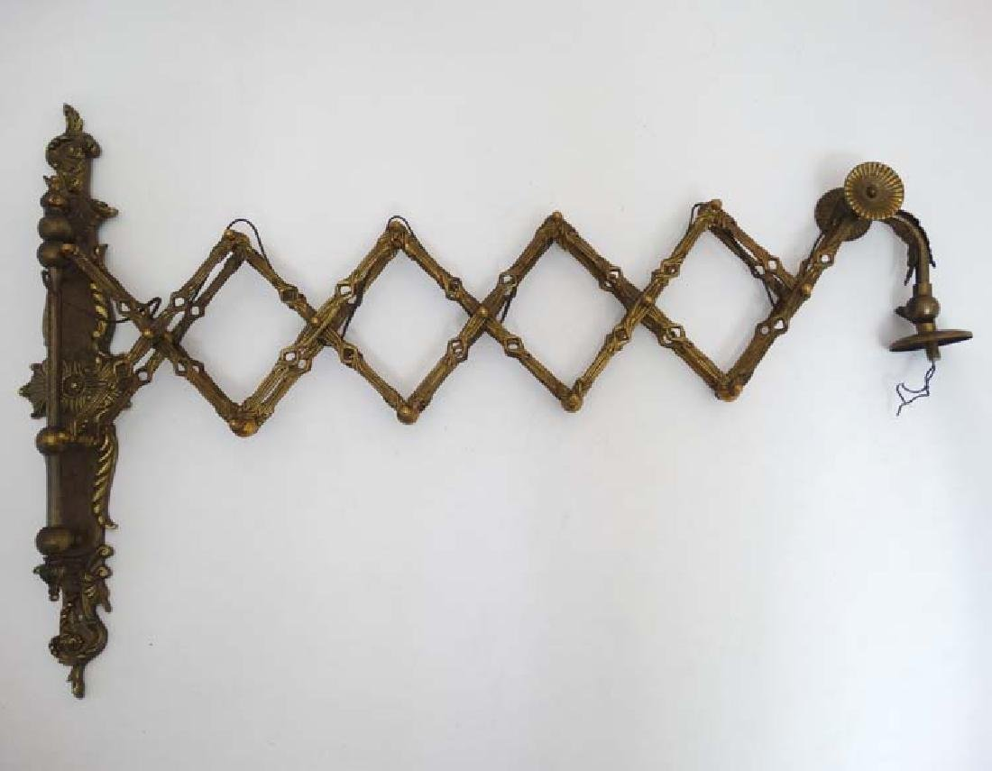 An early 20thC brass wall mounted reading light bracket