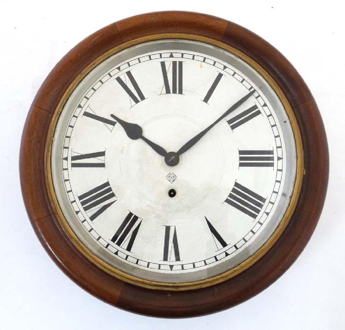 Ansonia wall clock: a mahogany cased 12'' wall