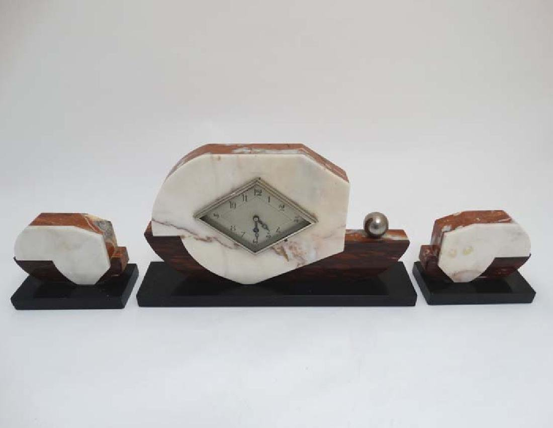 Art Deco Clock and Garnitures: an attractively cased