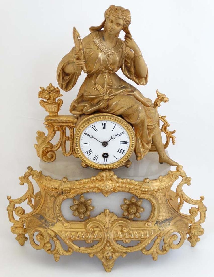 XIX Gilt figural French Clock, a white marble /