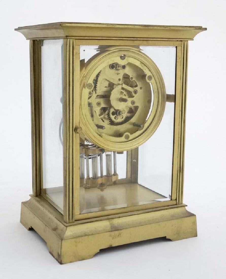 French Gilded Four- Glass Clock : a mantel clock with