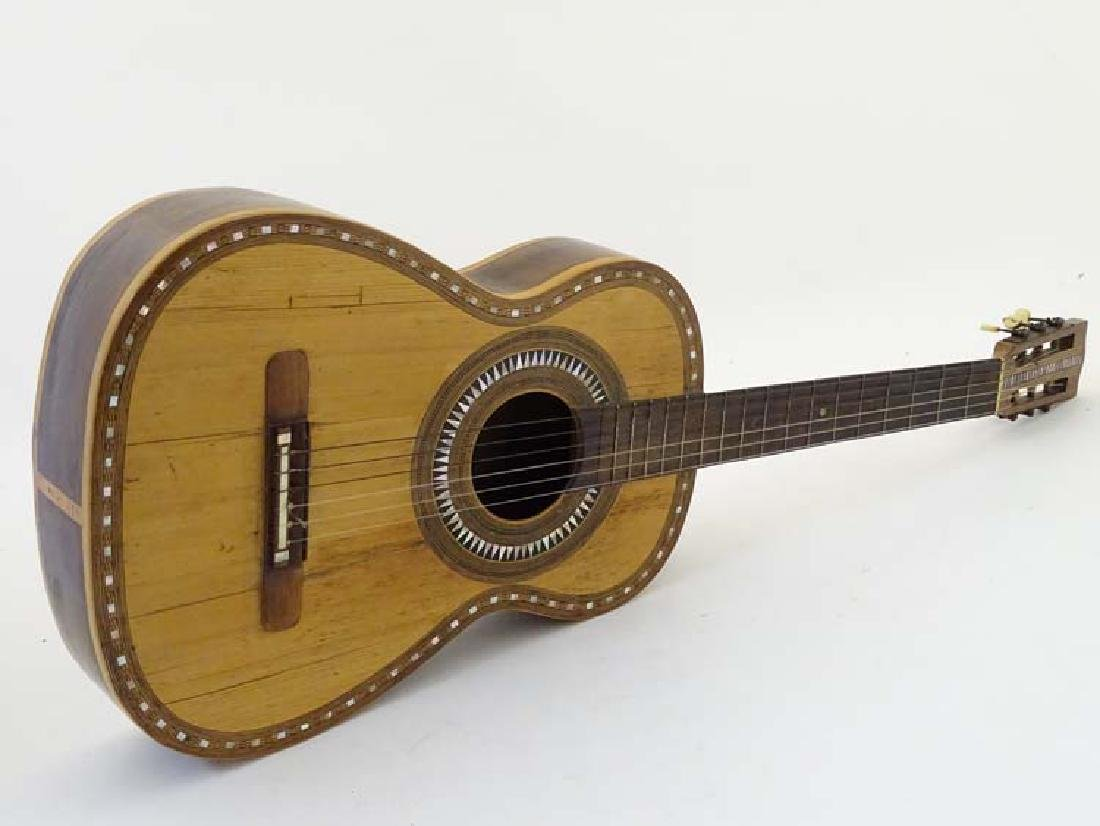 Musical Instruments : A late 19thC Classical Guitar ,