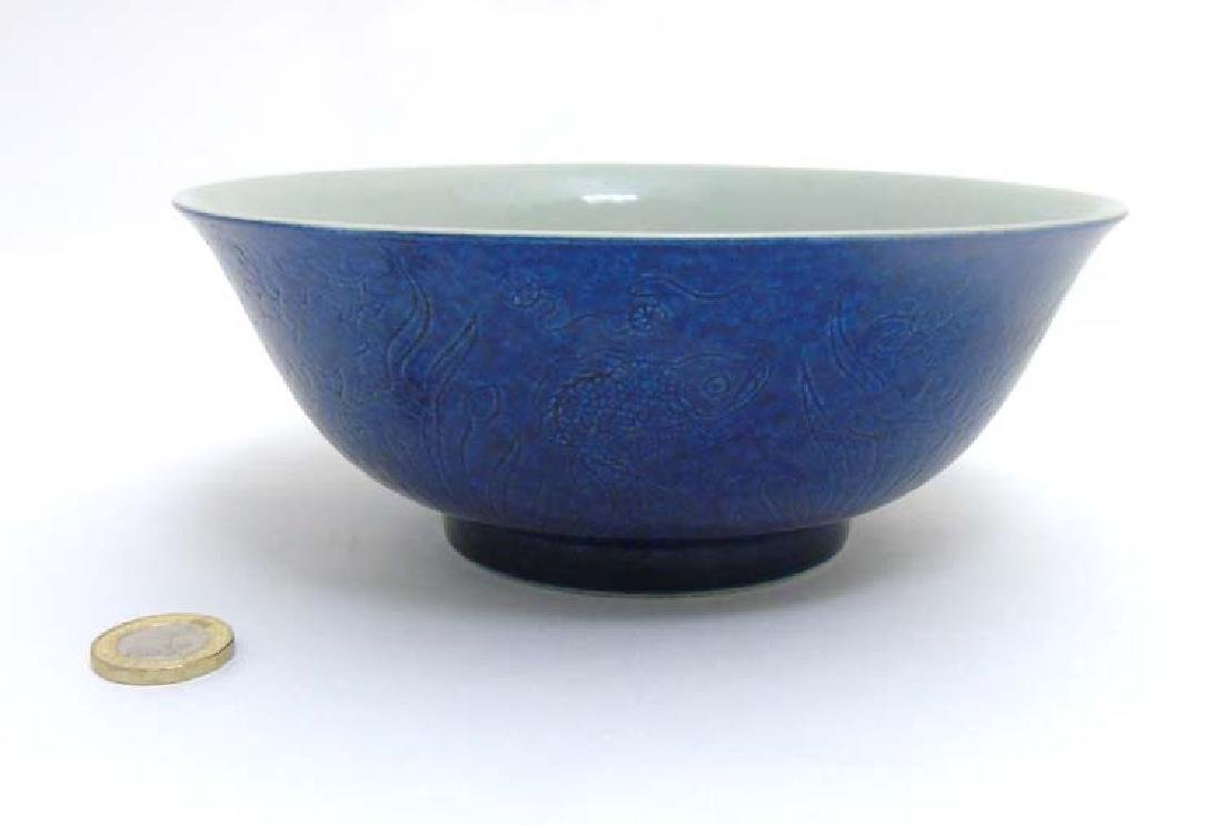 A Chinese blue monochrome fish pond bowl with a carved
