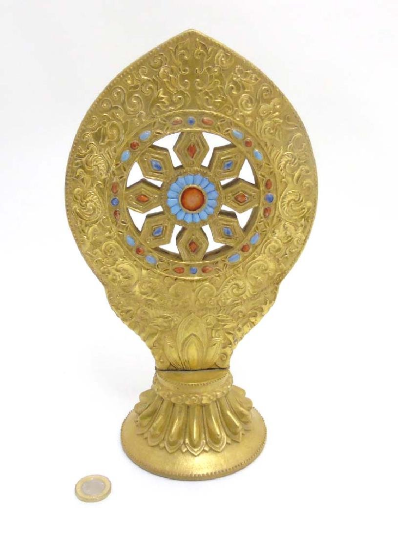 An Oriental Monstrance with the Wheel of Law / Wheel of