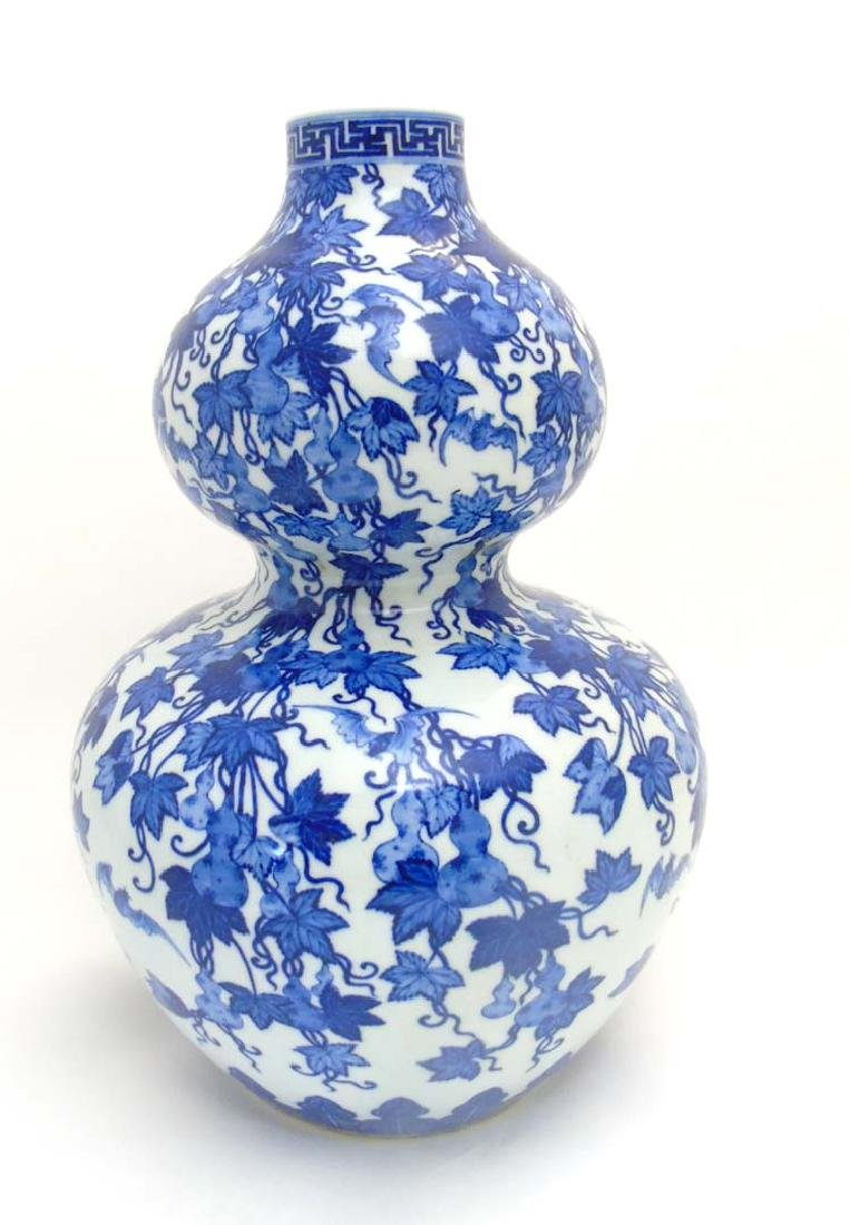 A Chinese Blue and White double gourd vase depicting