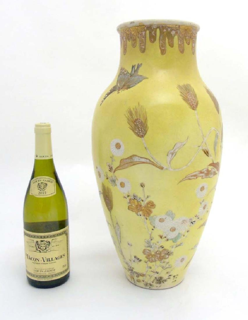 A large Japanese baluster vase, depicting butterflies