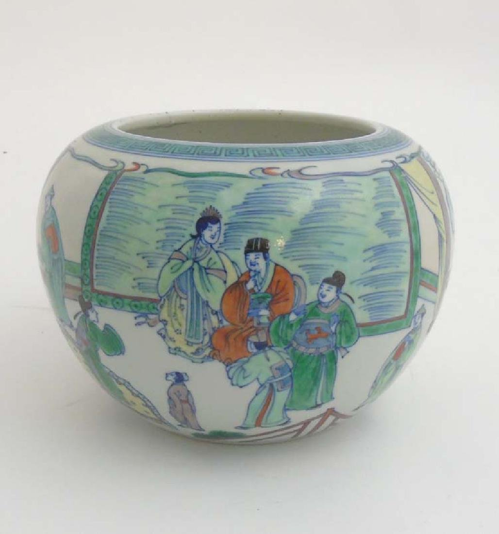 A Chinese Famille Verte vase depicting officials in a