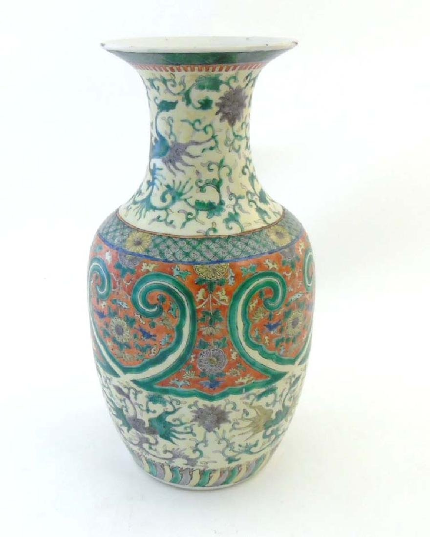A Chinese famille verte vase decorated with polychrome