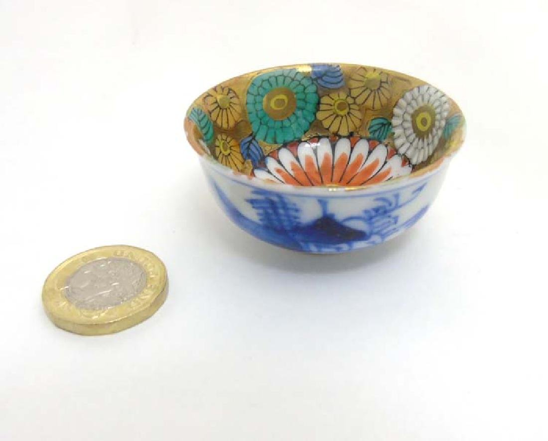A miniature oriental bowl, with blue and white