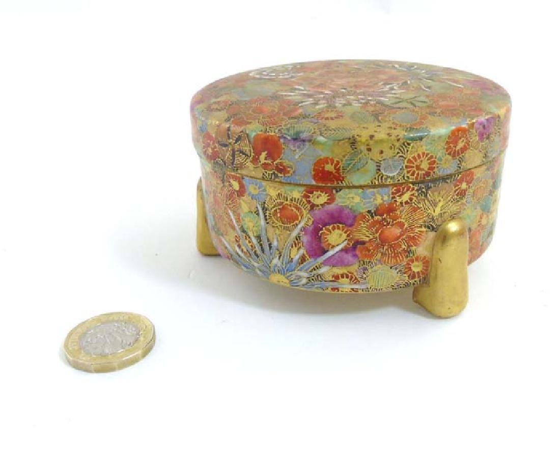 A Japanese millefleur satsuma tripod covered box of
