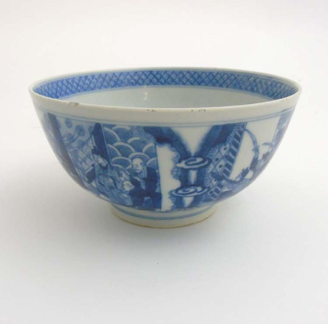 A Chinese blue and white bowl , decorated with children