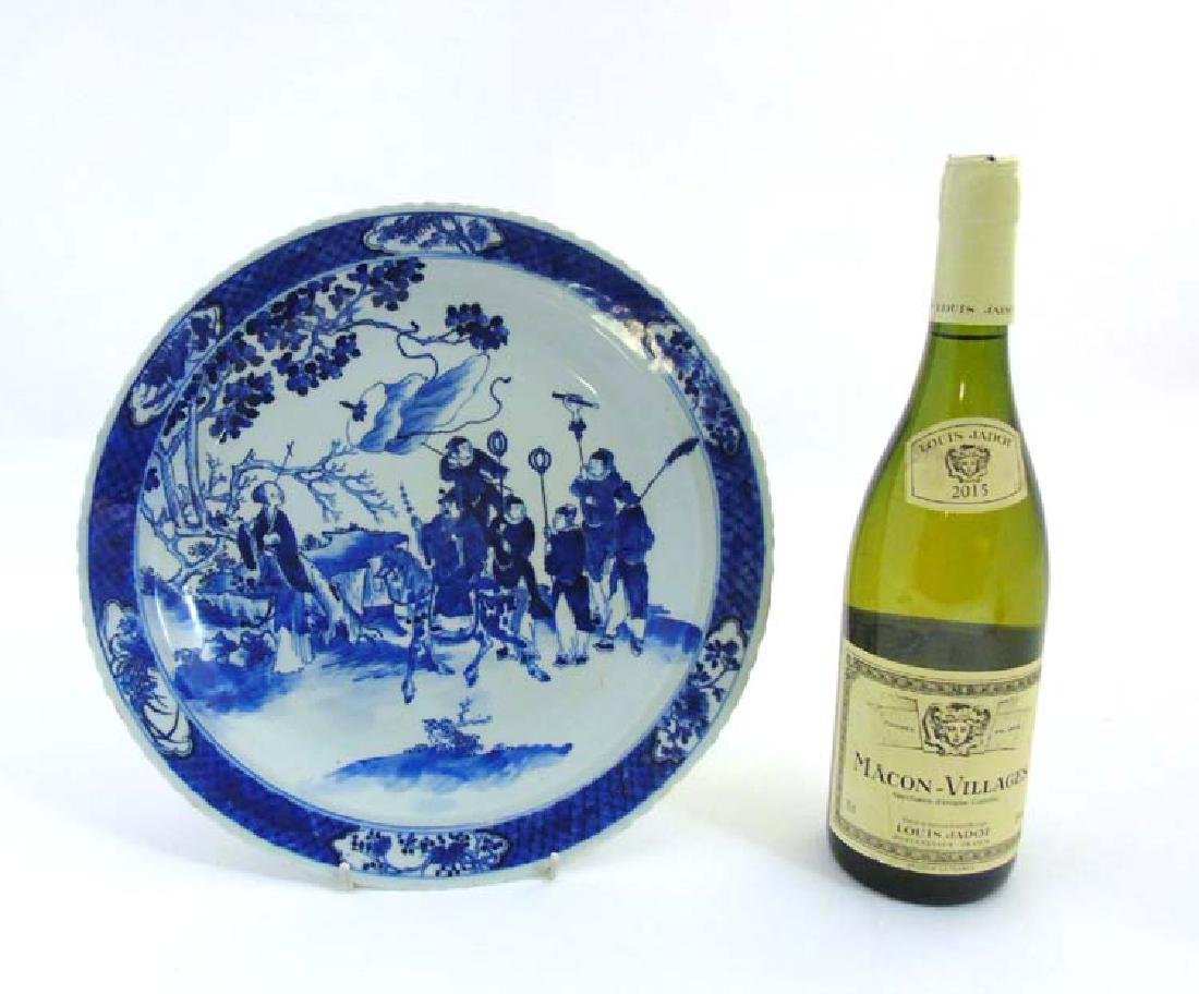 A Chinese blue and white charger/plate depicting