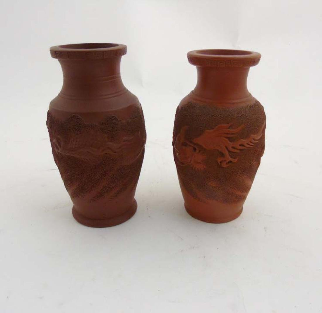 Two Japanese terracotta vases, depicting 3 clawed