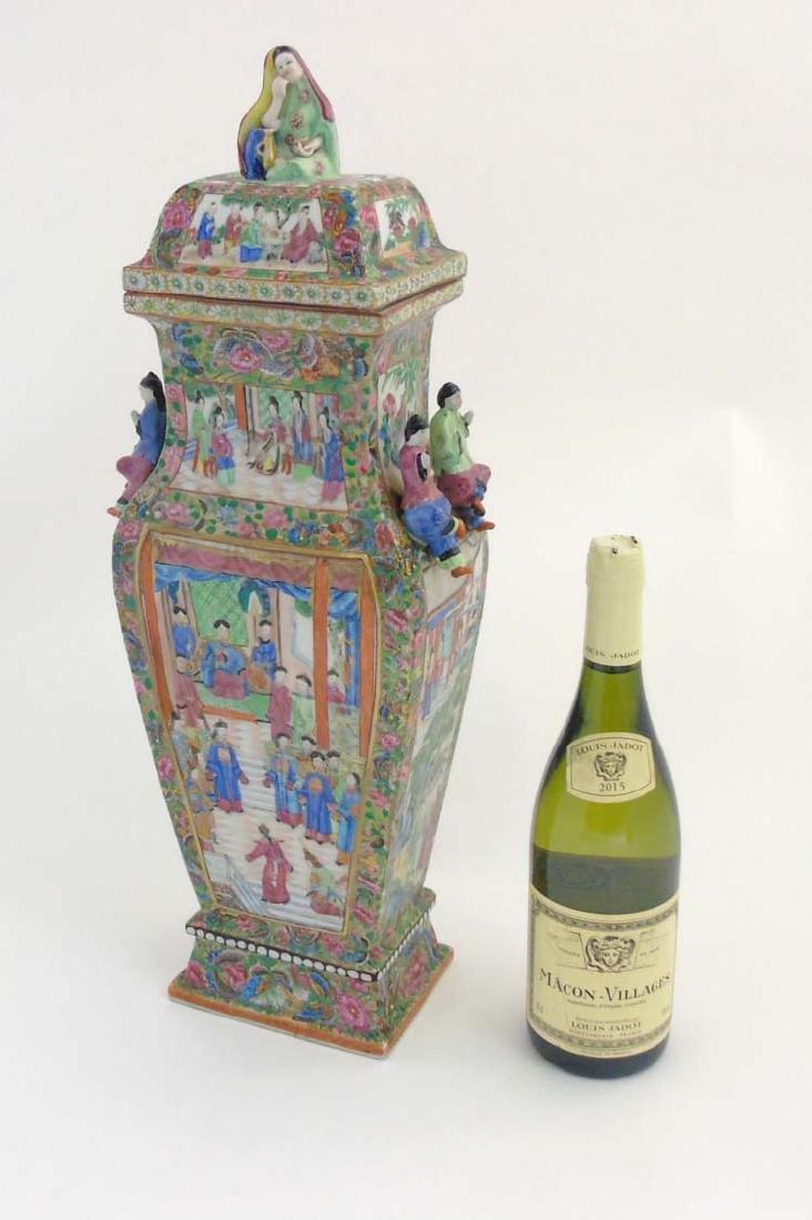An oriental famille rose Cantonese lidded vase of