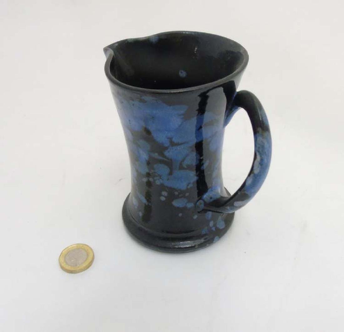 A Welsh black and blue mottled jug by Ewenny, makers