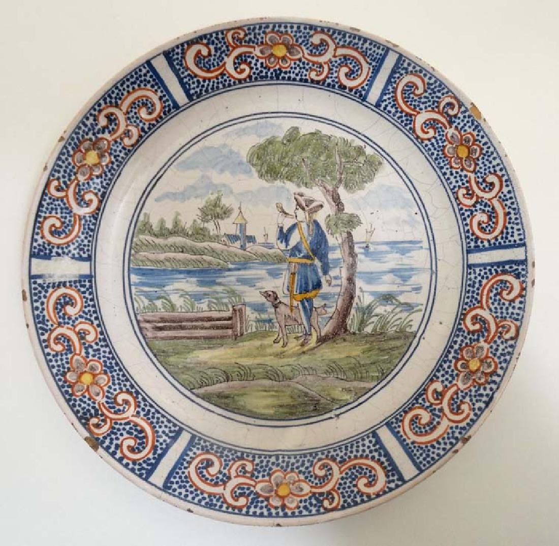 An early 19thC Dutch Delft plate , decorated with