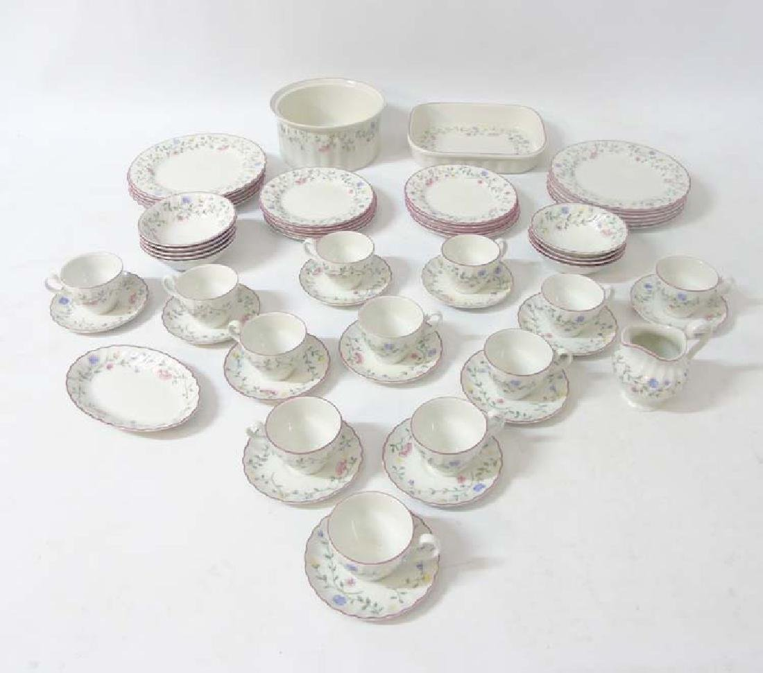 A 20thC China service to include cups and saucers,