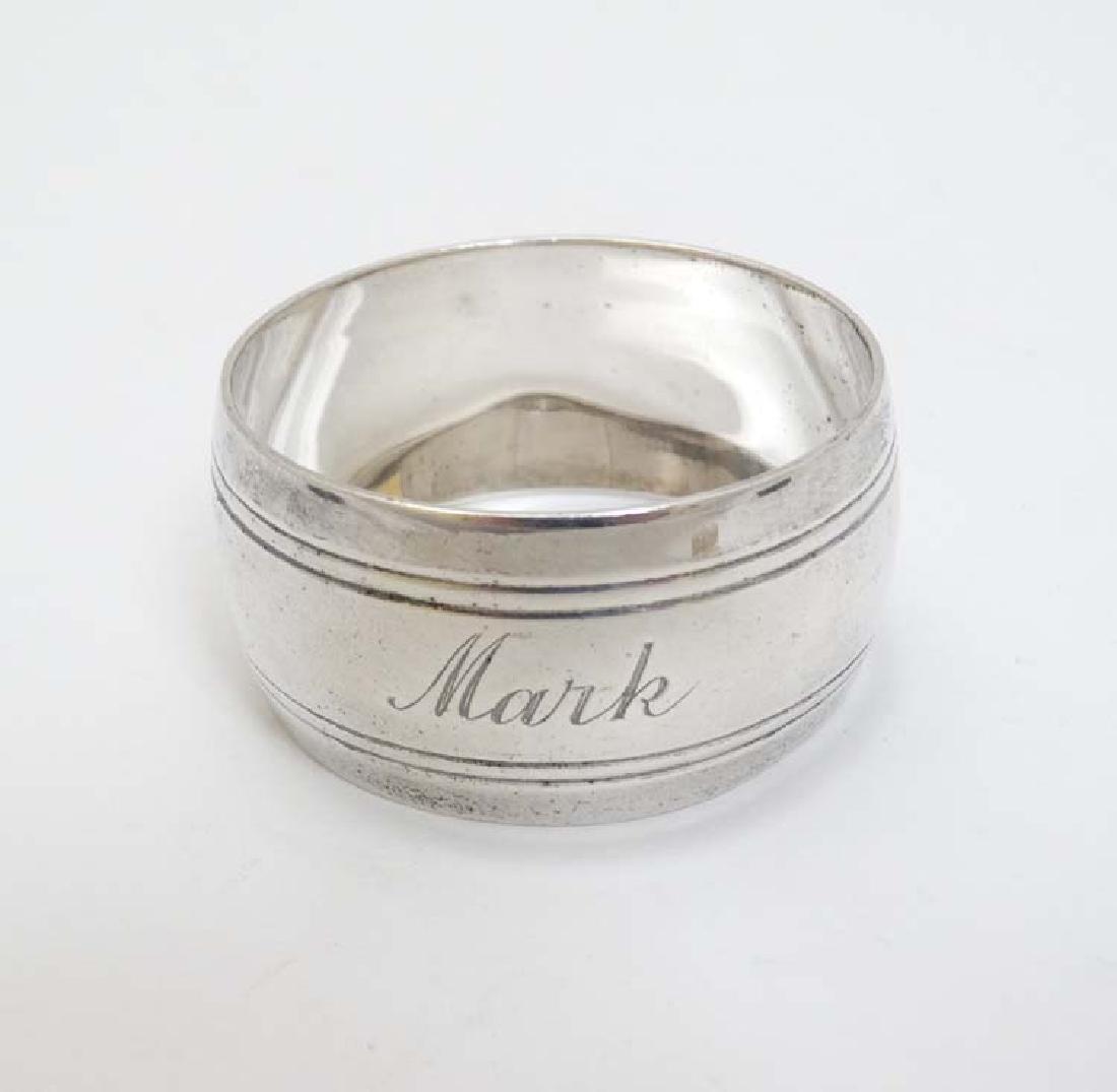 A silver napkin ring hallmarked Birmingham 1960 maker