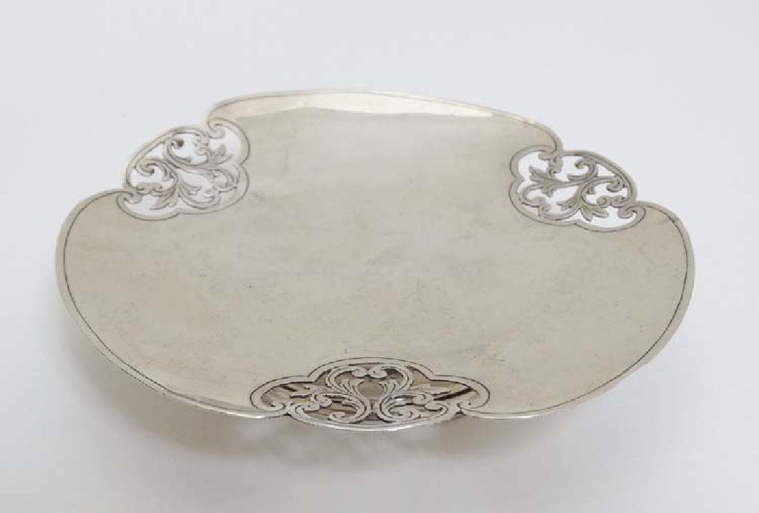 A small silver dish with pierced acanthus scroll