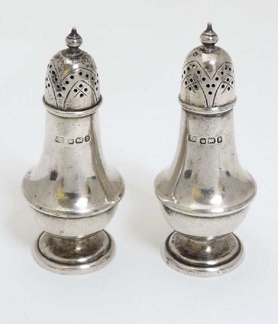 A pair of Victorian silver pepperettes hallmarked