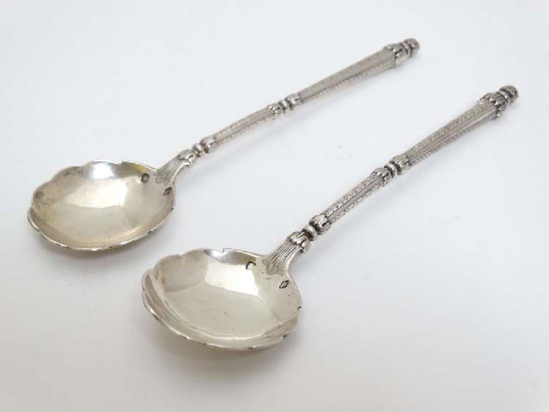 A pair of French silver spoons with engraved decoration