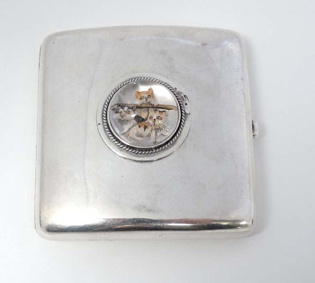 A silver cigarette case of shaped form Hallmarked