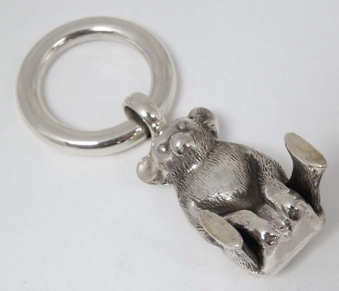 A 925 silver rattle / charm formed as a Teddy bear. 3''