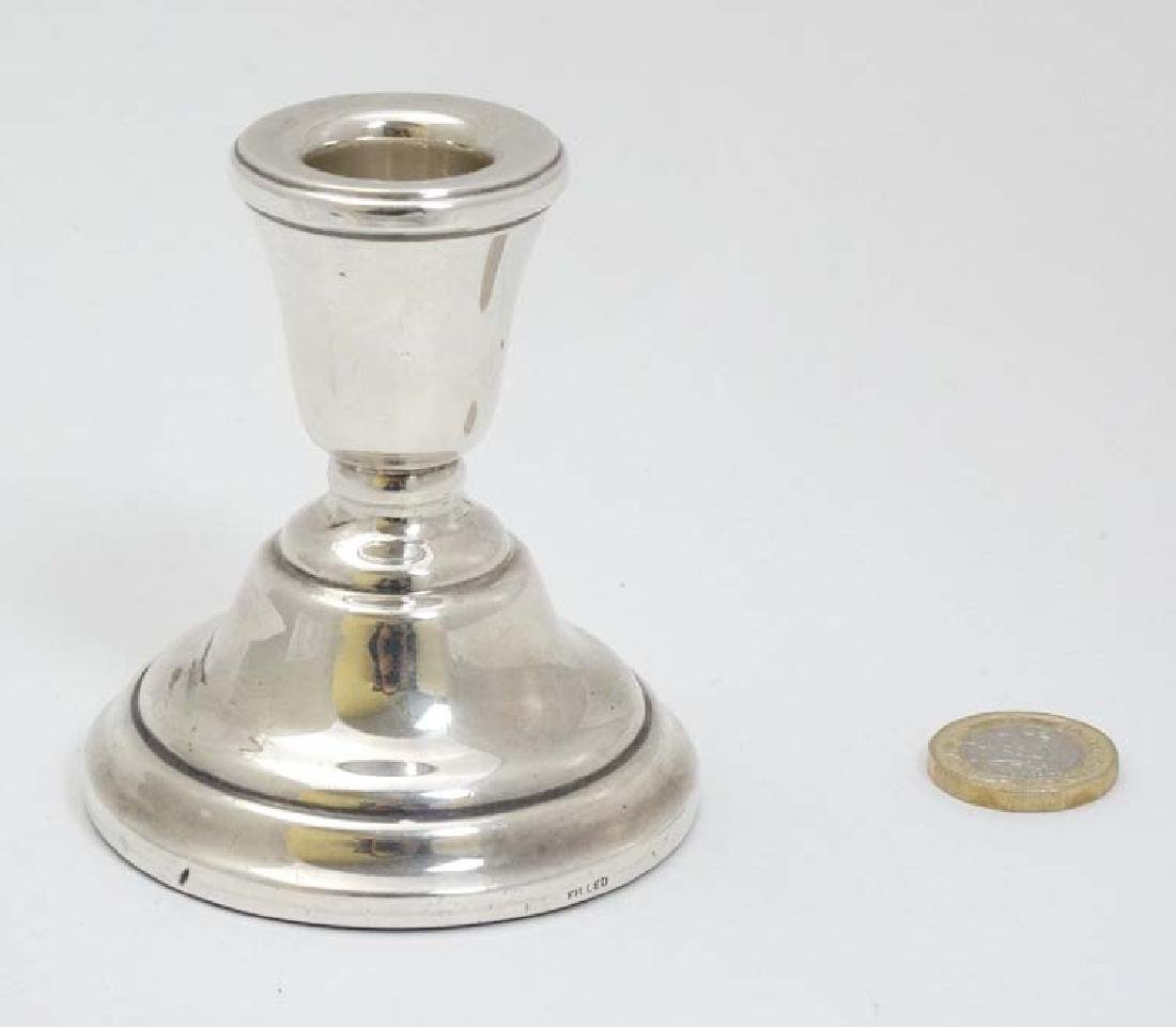 A silver candlestick hallmarked Birmingham 1976 maker